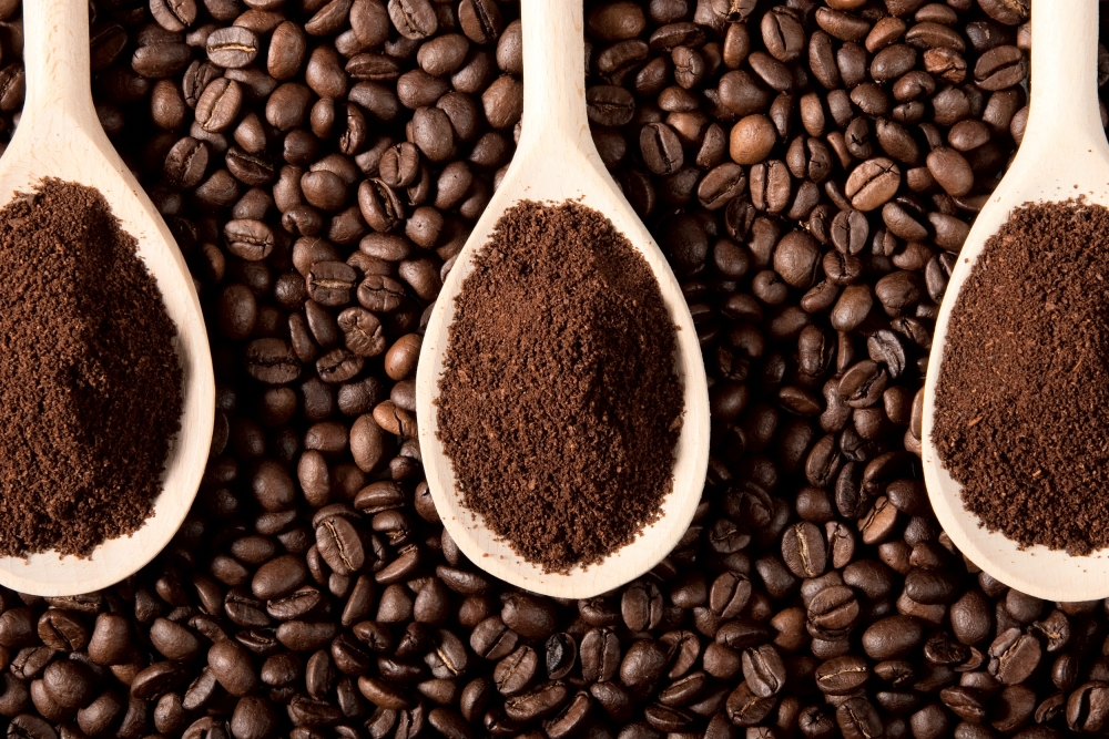 ground-coffee-on-coffee-beans-1